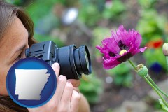 ar a female photographer photographing a flower close-up