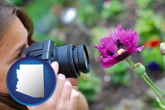 az map icon and a female photographer photographing a flower close-up