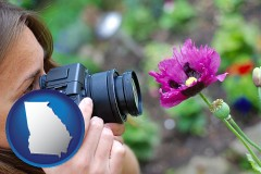 ga map icon and a female photographer photographing a flower close-up
