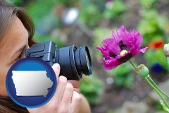ia map icon and a female photographer photographing a flower close-up
