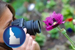 idaho map icon and a female photographer photographing a flower close-up