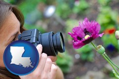 la map icon and a female photographer photographing a flower close-up