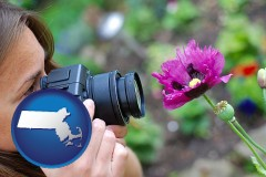 ma map icon and a female photographer photographing a flower close-up
