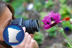 mn map icon and a female photographer photographing a flower close-up