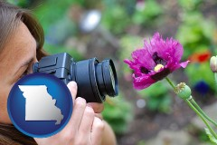 missouri map icon and a female photographer photographing a flower close-up