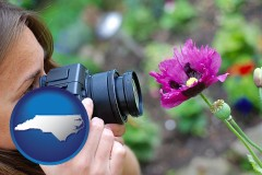 nc a female photographer photographing a flower close-up