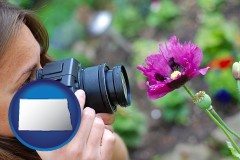 north-dakota map icon and a female photographer photographing a flower close-up