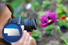 ne a female photographer photographing a flower close-up