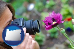 or a female photographer photographing a flower close-up