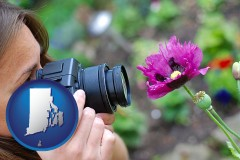 ri map icon and a female photographer photographing a flower close-up