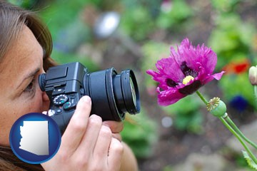 a female photographer photographing a flower close-up - with Arizona icon
