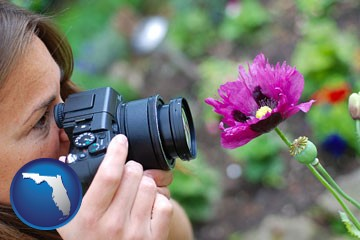 a female photographer photographing a flower close-up - with Florida icon
