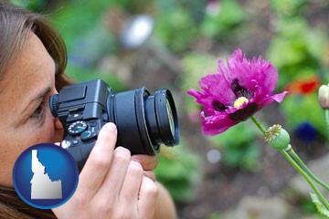 a female photographer photographing a flower close-up - with Idaho icon