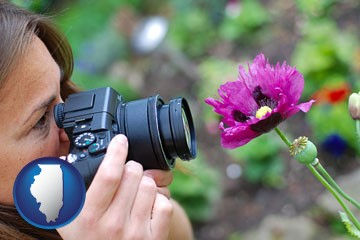 a female photographer photographing a flower close-up - with Illinois icon