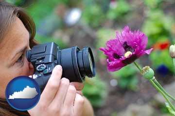 a female photographer photographing a flower close-up - with Kentucky icon