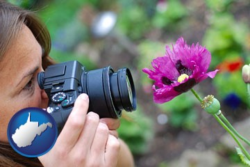 a female photographer photographing a flower close-up - with West Virginia icon